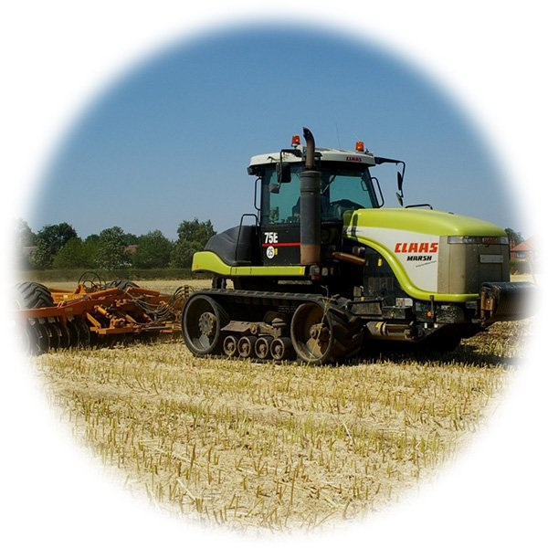 A farmer harvesting crops using a tractor and other machinery