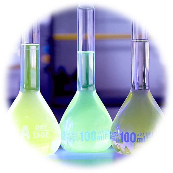 Volumetric flasks filled with liquids of differing formulations